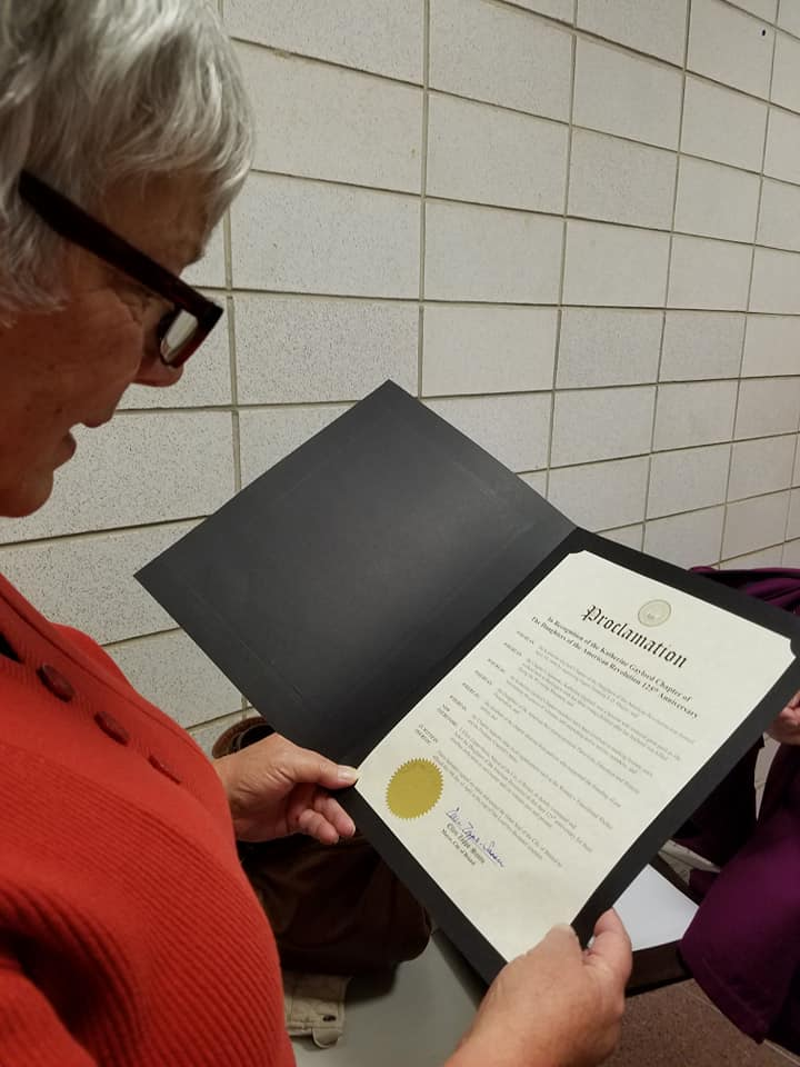 Image of Member with proclamation
